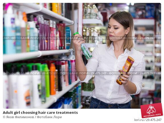 Купить «Adult girl choosing hair care treatments», фото № 29475247, снято 31 января 2018 г. (c) Яков Филимонов / Фотобанк Лори