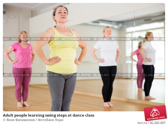 Adult people learning swing steps at dance class. Стоковое фото, фотограф Яков Филимонов / Фотобанк Лори