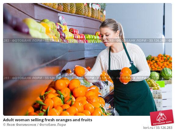 Купить «Adult woman selling fresh oranges and fruits», фото № 33126283, снято 24 мая 2020 г. (c) Яков Филимонов / Фотобанк Лори