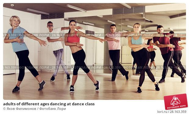 Купить «adults of different ages dancing at dance class», фото № 28163359, снято 9 октября 2017 г. (c) Яков Филимонов / Фотобанк Лори