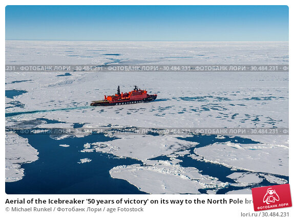 Купить «Aerial of the Icebreaker '50 years of victory' on its way to the North Pole breaking through the ice, Arctic», фото № 30484231, снято 3 августа 2018 г. (c) age Fotostock / Фотобанк Лори