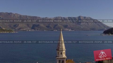 Купить «Aerial View - Adriatic Sea Near Old Town Budva», видеоролик № 28598727, снято 23 февраля 2018 г. (c) Pavel Biryukov / Фотобанк Лори
