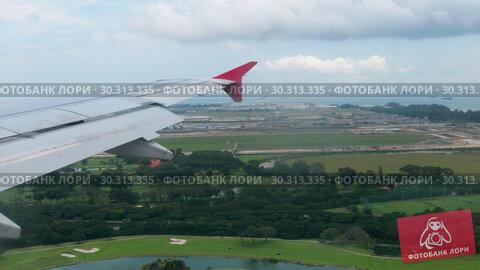 Купить «Aerial view from descending airplane», видеоролик № 30313335, снято 2 февраля 2019 г. (c) Игорь Жоров / Фотобанк Лори