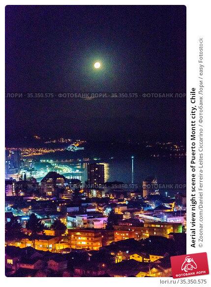 Aerial view night scene of Puerto Montt city, Chile. Стоковое фото, фотограф Zoonar.com/Daniel Ferreira-Leites Ciccarino / easy Fotostock / Фотобанк Лори