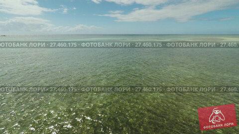 Купить «Aerial view of Bohol coast Island. Aerial. Flight is close above the water. Philippines.», видеоролик № 27460175, снято 20 января 2018 г. (c) Mikhail Davidovich / Фотобанк Лори