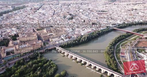 Aerial view of cityscape of Cordoba with Roman Bridge over the Guadalquivir and the Mosque-Cathedral of Cordoba. Стоковое видео, видеограф Яков Филимонов / Фотобанк Лори