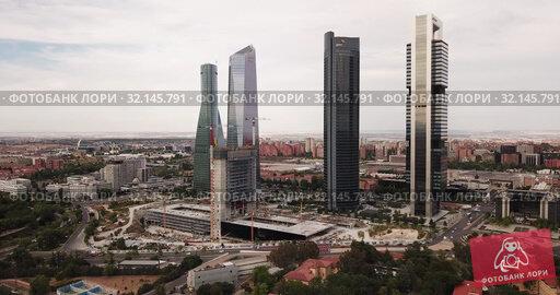 Купить «Aerial view of four Towers Business Area (Cuatro Torres) in Madrid, Spain», видеоролик № 32145791, снято 16 июня 2019 г. (c) Яков Филимонов / Фотобанк Лори