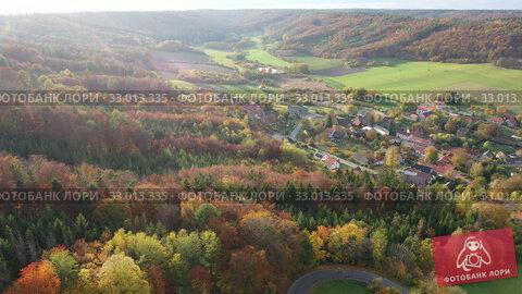 Купить «Aerial view of Kalivody - Bdin with landscape and buildings, Czech Republic», видеоролик № 33013335, снято 19 октября 2019 г. (c) Яков Филимонов / Фотобанк Лори