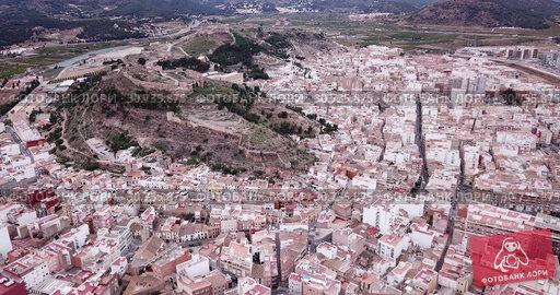 Купить «Aerial view of Sagunto city and antique roman fortress, Valencia, Spain», видеоролик № 30735875, снято 19 марта 2019 г. (c) Яков Филимонов / Фотобанк Лори