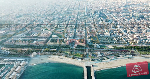 Купить «Aerial view of seaside area of Barcelona with harbor on sunny day, Catalonia, Spain», видеоролик № 30616955, снято 16 ноября 2018 г. (c) Яков Филимонов / Фотобанк Лори