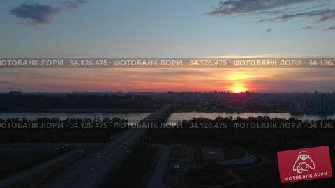Купить «Aerial view to bridge, beauty sunset summer sky, Barnaul city, Siberia, Russia», видеоролик № 34126475, снято 7 июня 2020 г. (c) Jan Jack Russo Media / Фотобанк Лори