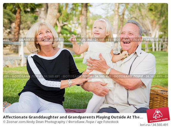 Affectionate Granddaughter and Grandparents Playing Outside At The... Стоковое фото, фотограф Zoonar.com/Andy Dean Photography / age Fotostock / Фотобанк Лори