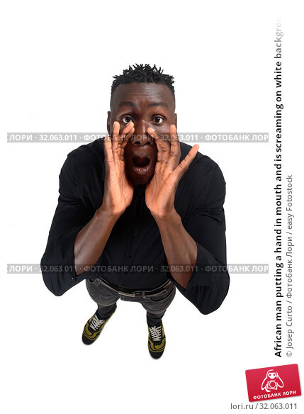 African man putting a hand in mouth and is screaming on white background. Стоковое фото, фотограф Josep Curto / easy Fotostock / Фотобанк Лори