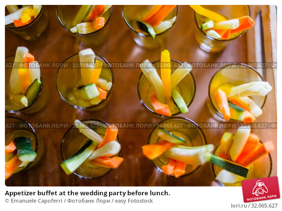 Appetizer buffet at the wedding party before lunch. Стоковое фото, фотограф Emanuele Capoferri / easy Fotostock / Фотобанк Лори