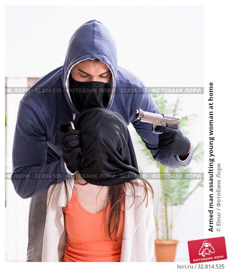 Купить «Armed man assaulting young woman at home», фото № 32814535, снято 15 декабря 2017 г. (c) Elnur / Фотобанк Лори