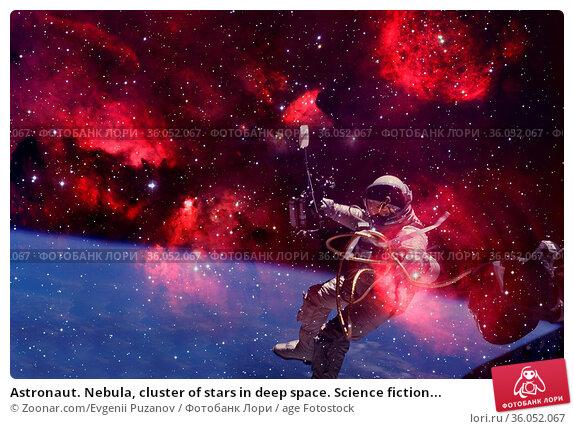 Astronaut. Nebula, cluster of stars in deep space. Science fiction... Стоковое фото, фотограф Zoonar.com/Evgenii Puzanov / age Fotostock / Фотобанк Лори