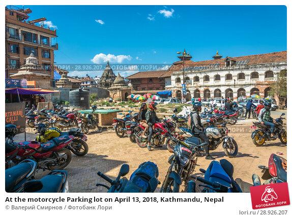 Купить «At the motorcycle Parking lot on April 13, 2018, Kathmandu, Nepal», фото № 28926207, снято 13 апреля 2018 г. (c) Валерий Смирнов / Фотобанк Лори