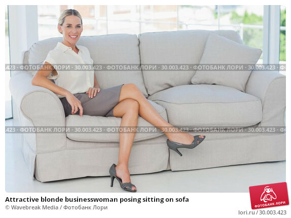 Купить «Attractive blonde businesswoman posing sitting on sofa», фото № 30003423, снято 14 марта 2013 г. (c) Wavebreak Media / Фотобанк Лори