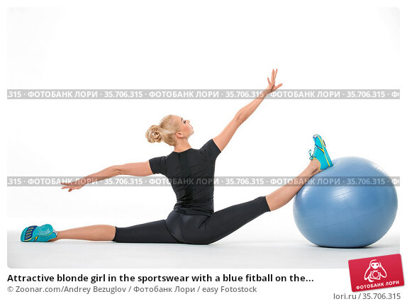 Attractive blonde girl in the sportswear with a blue fitball on the... Стоковое фото, фотограф Zoonar.com/Andrey Bezuglov / easy Fotostock / Фотобанк Лори