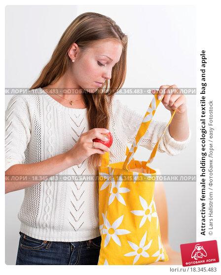 Купить «Attractive female holding ecological textile bag and apple», фото № 18345483, снято 20 ноября 2019 г. (c) easy Fotostock / Фотобанк Лори