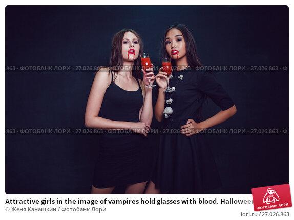 Купить «Attractive girls in the image of vampires hold glasses with blood. Halloween.», фото № 27026863, снято 22 сентября 2017 г. (c) Женя Канашкин / Фотобанк Лори
