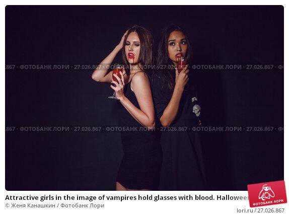Купить «Attractive girls in the image of vampires hold glasses with blood. Halloween.», фото № 27026867, снято 22 сентября 2017 г. (c) Женя Канашкин / Фотобанк Лори