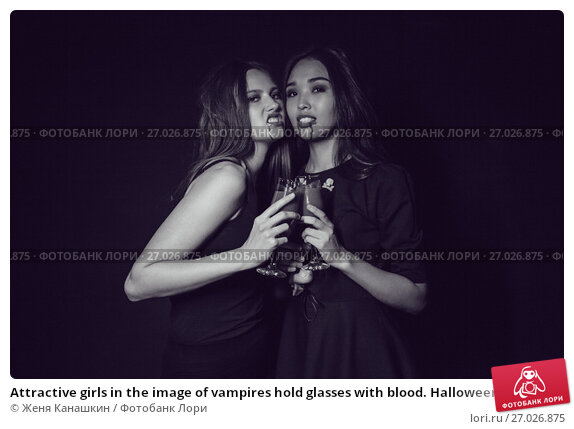 Купить «Attractive girls in the image of vampires hold glasses with blood. Halloween.», фото № 27026875, снято 22 сентября 2017 г. (c) Женя Канашкин / Фотобанк Лори