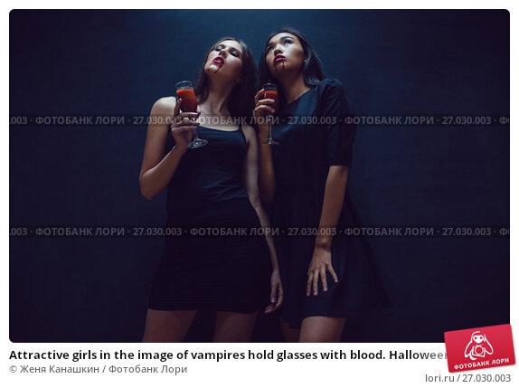 Купить «Attractive girls in the image of vampires hold glasses with blood. Halloween.», фото № 27030003, снято 22 сентября 2017 г. (c) Женя Канашкин / Фотобанк Лори
