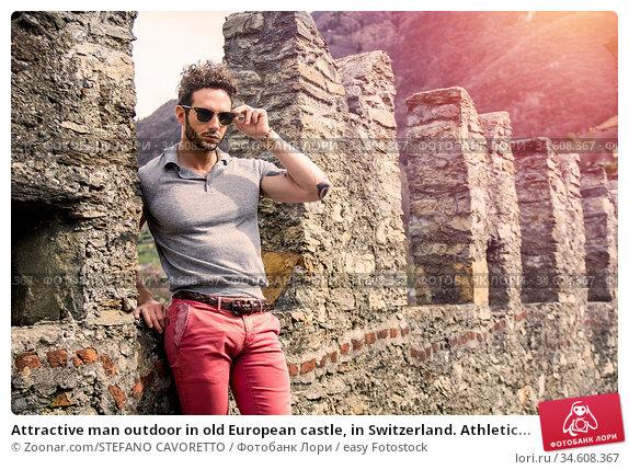 Attractive man outdoor in old European castle, in Switzerland. Athletic... Стоковое фото, фотограф Zoonar.com/STEFANO CAVORETTO / easy Fotostock / Фотобанк Лори