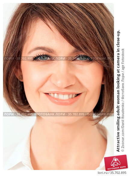 Attractive smiling adult woman looking at camera in close-up. Стоковое фото, фотограф Zoonar.com/Danil Roudenko / age Fotostock / Фотобанк Лори