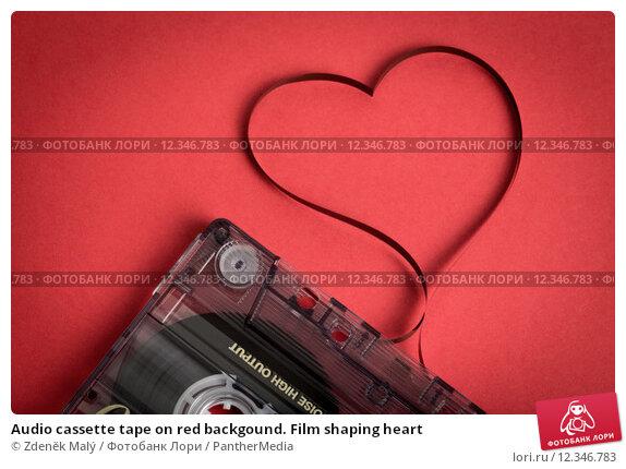 Купить «Audio cassette tape on red backgound. Film shaping heart», фото № 12346783, снято 20 января 2019 г. (c) PantherMedia / Фотобанк Лори