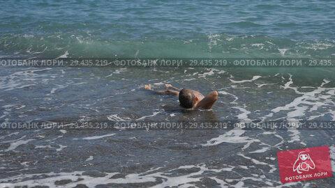Купить «Baby on the beach, in the maritime wave. boy on the golden sand plays in the surf.», видеоролик № 29435219, снято 19 марта 2019 г. (c) Константин Мерцалов / Фотобанк Лори