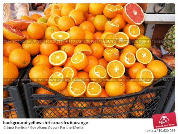 background yellow christmas fruit orange. Стоковое фото, фотограф Inna Nerlich / PantherMedia / Фотобанк Лори