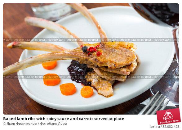 Купить «Baked lamb ribs with spicy sauce and carrots served at plate», фото № 32082423, снято 19 октября 2019 г. (c) Яков Филимонов / Фотобанк Лори