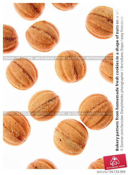 Купить «Bakery pattern from homemade fresh cookies in a shape of nuts on a white background.», фото № 34133959, снято 2 июля 2020 г. (c) easy Fotostock / Фотобанк Лори