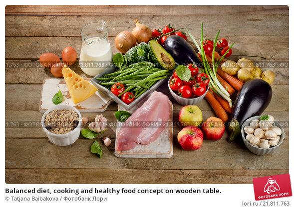 Купить «Balanced diet, cooking and healthy food concept on wooden table.», фото № 21811763, снято 20 января 2016 г. (c) Tatjana Baibakova / Фотобанк Лори