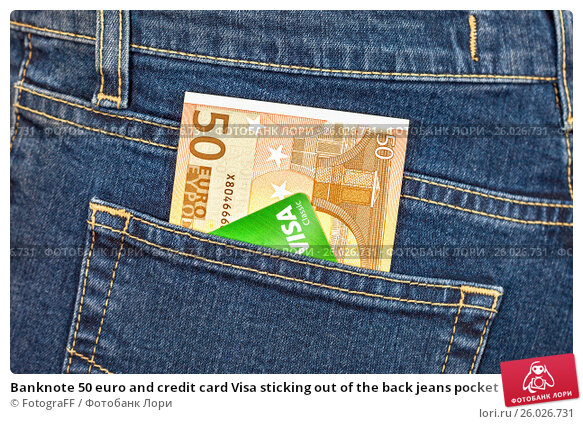Banknote 50 euro and credit card Visa sticking out of the back jeans pocket, фото № 26026731, снято 28 июня 2017 г. (c) FotograFF / Фотобанк Лори