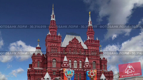 Купить «Banners with medals and ribbons on the facade of Historical museum (Victory Day decoration) against the sky, Red Square, Moscow, Russia», видеоролик № 30314019, снято 15 марта 2019 г. (c) Владимир Журавлев / Фотобанк Лори