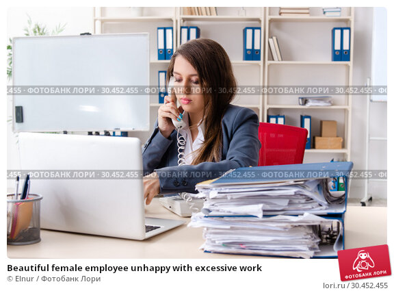 Beautiful female employee unhappy with excessive work. Стоковое фото, фотограф Elnur / Фотобанк Лори