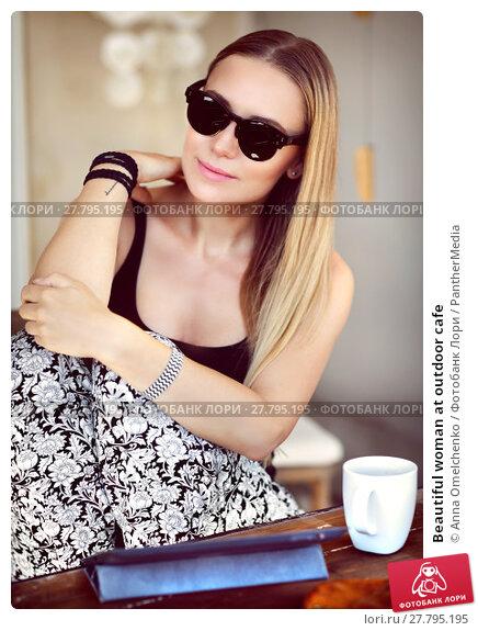 Купить «Beautiful woman at outdoor cafe», фото № 27795195, снято 21 февраля 2018 г. (c) PantherMedia / Фотобанк Лори