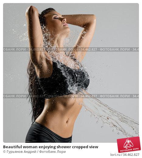 Beautiful woman enjoying shower cropped view. Стоковое фото, фотограф Гурьянов Андрей / Фотобанк Лори