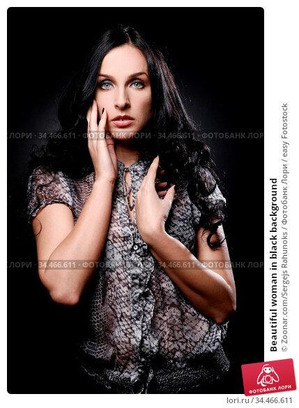 Beautiful woman in black background. Стоковое фото, фотограф Zoonar.com/Sergejs Rahunoks / easy Fotostock / Фотобанк Лори