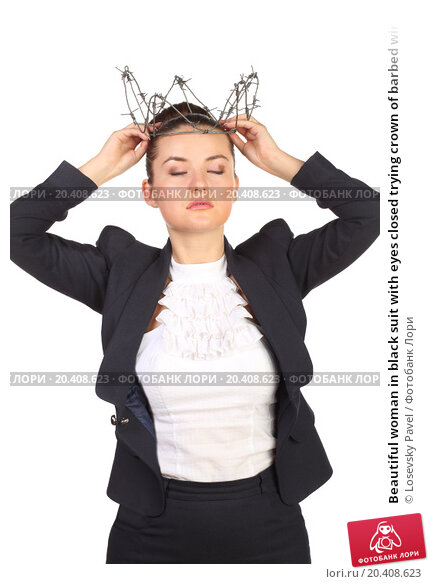 Купить «Beautiful woman in black suit with eyes closed trying crown of barbed wire fence», фото № 20408623, снято 7 июня 2014 г. (c) Losevsky Pavel / Фотобанк Лори