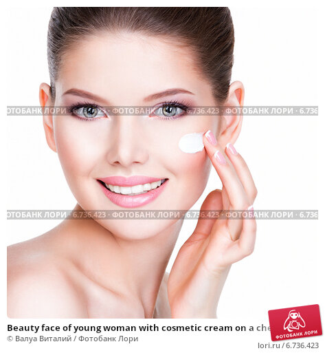 Beauty face of young woman with cosmetic cream on a cheek., фото № 6736423, снято 12 апреля 2014 г. (c) Валуа Виталий / Фотобанк Лори