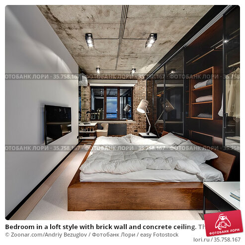 Bedroom in a loft style with brick wall and concrete ceiling. There... Стоковое фото, фотограф Zoonar.com/Andriy Bezuglov / easy Fotostock / Фотобанк Лори