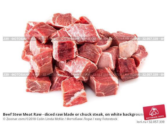 Beef Stew Meat Raw - diced raw blade or chuck steak, on white background. Стоковое фото, фотограф Zoonar.com/©2018 Colin Linda McKie / easy Fotostock / Фотобанк Лори