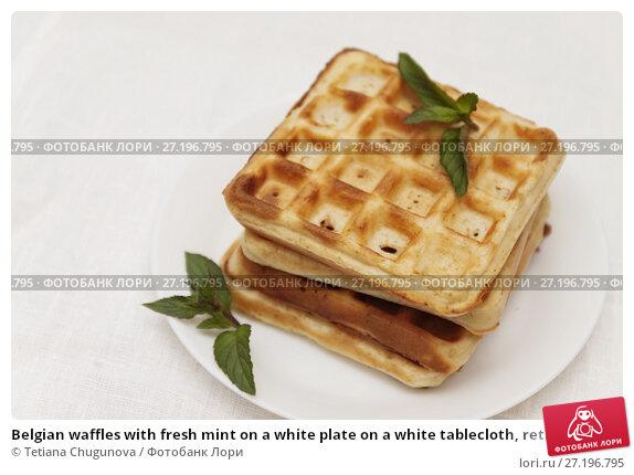 Купить «Belgian waffles with fresh mint on a white plate on a white tablecloth, retro toning, close-up», фото № 27196795, снято 28 августа 2017 г. (c) Tetiana Chugunova / Фотобанк Лори