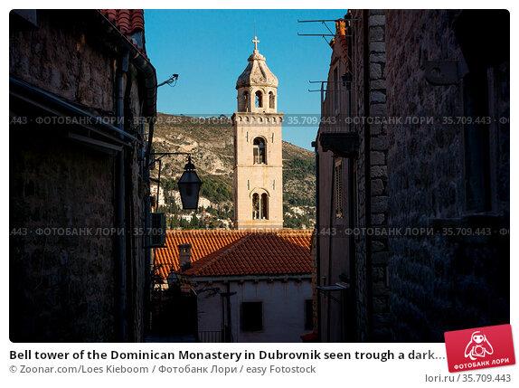 Bell tower of the Dominican Monastery in Dubrovnik seen trough a dark... Стоковое фото, фотограф Zoonar.com/Loes Kieboom / easy Fotostock / Фотобанк Лори