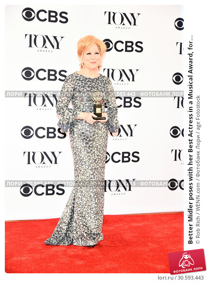 Купить «Better Midler poses with her Best Actress in a Musical Award, for playing the title role in 'Hello, Dolly!,' at the 71st Annual Tony Awards held at Radio...», фото № 30593443, снято 11 июня 2017 г. (c) age Fotostock / Фотобанк Лори