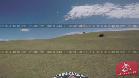 Купить «Bike nature Enduro journey with dirt bike high in the Caucasian mountains, hills, valleys», видеоролик № 28306291, снято 15 апреля 2018 г. (c) Aleksejs Bergmanis / Фотобанк Лори